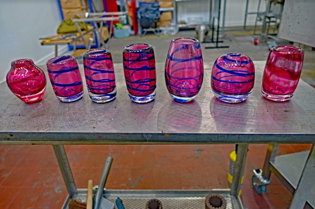 Pink and blue vases on table top